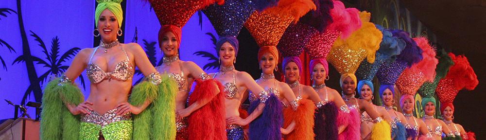 twelve showgirls lined up